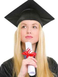 Portrait of thoughtful woman in graduation gown with diploma